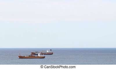 Freight ships anchored in open sea - Freight ships anchored...