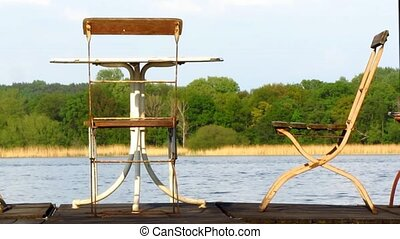 Two metal chairs table wooden jetty - Two old metal chairs...