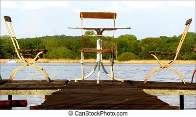Three chairs and table wooden jetty - Three old metal chairs...