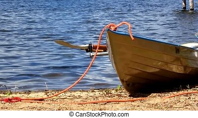 Rowing boat on the beach - White rowing boat laying on the...