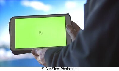 Ipad Tablet PC with Green Screen city background