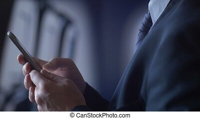 Business person traveling on air plane checking mobile cell...