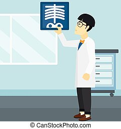Doctor examining radiograph - An asian doctor examining a...