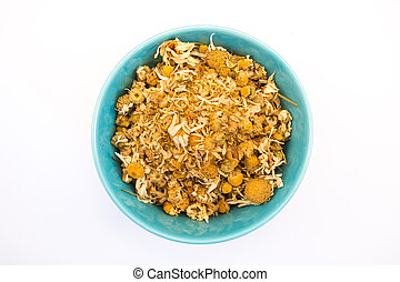 Bowl of dry daisy - Tea herb in bowl on white background