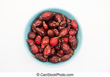 Bowl of rosehip - Tea herb in bowl on white background