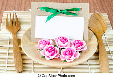 Romantic dinner table setting with blank note.
