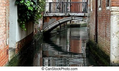 Small bridge above canal in Venice
