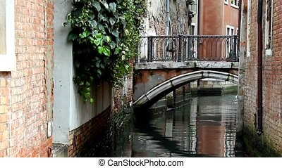 Venice. Canal and bridge - Bridge above small canal between...