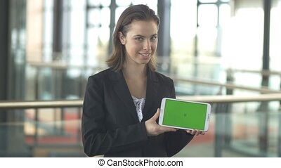 Selling with green screen tablet sales logo promotion in corporate office
