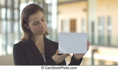 Logo sales promotion woman in suit holding blank white card