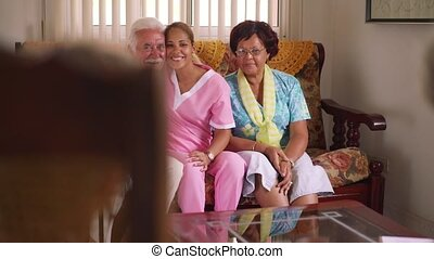 Portrait Of Nurse And Happy Old People In Hospice - Old...