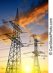 High voltage towers against the sunset.