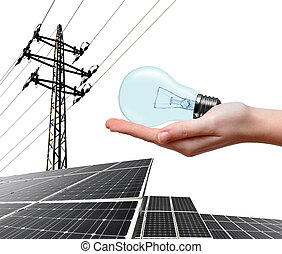 Clean energy concept. - Hand holding lightbulb. In the...