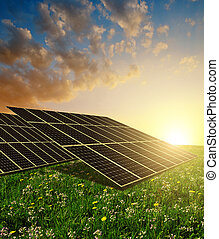 Solar energy panels against sunset skyClean energy