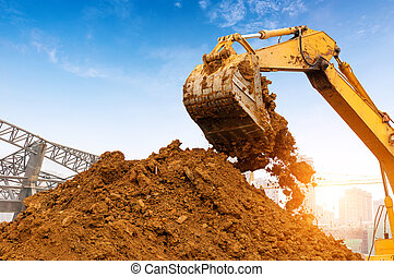 excavator in action - Close-up of a construction site...