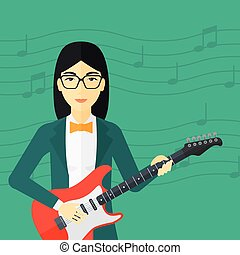 Musician playing electric guitar. - An asian smiling woman...