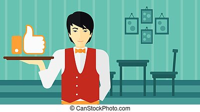 Waiter with like button - An asian waiter carrying a tray...