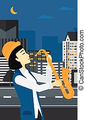 Woman playing saxophone - An asian musician playing...