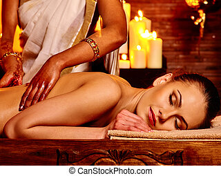 Woman having Ayurvedic spa treatment. - Young woman having...