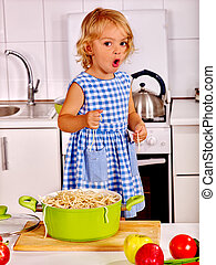 Children cooking at kitchen. - Children eating spaghetti at...