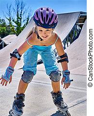 Girl riding on roller skates in skatepark - Fun active...