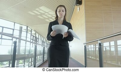 young businesswoman walking outside Slow motion
