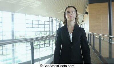 businesswoman walking in office building Slow motion