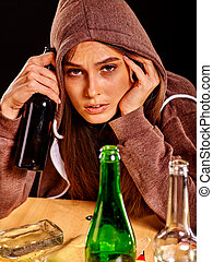 Drunk girl holding green glass bottle of vodka - Drunk girl...