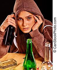 Drunk girl holding green glass bottle of vodka. - Drunk girl...