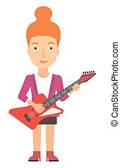 Musician playing electric guitar. - A smiling musician...