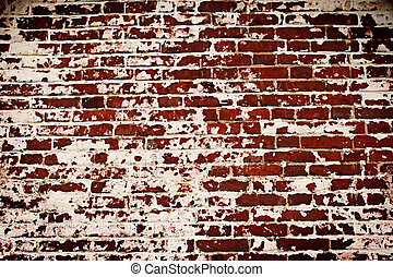 Old brick wall with remains of plaster
