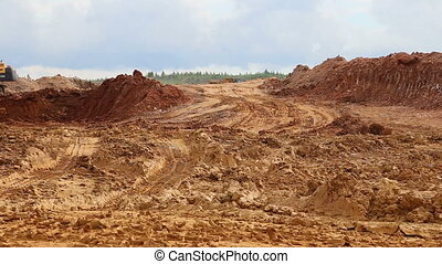 The dump truck in the open pit mine