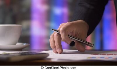 Business person working on tax return finance forms at desk...