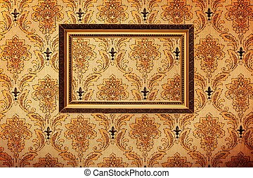 Vintage gold plated picture frame on retro wallpaper...