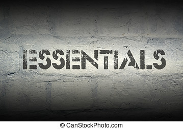 essentials stencil print on the grunge white brick wall