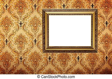 Vintage gold plated picture frame  on retro wallpaper
