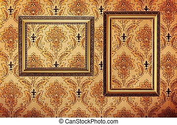 Vintage gold plated picture frames on retro wallpaper...