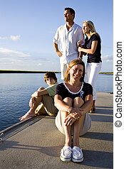 Mother and family, sunny day on dock by water