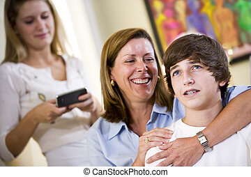Loving mother with arm around teenage son