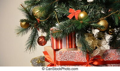 Box with ribbon under cute christmas fir tree - Colorful...