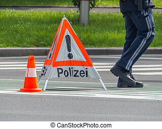 police operation roadblock - a road is blocked with a police...