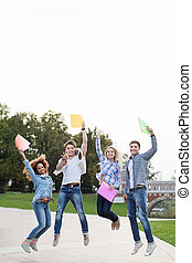 Smiling students - Jumping people in park