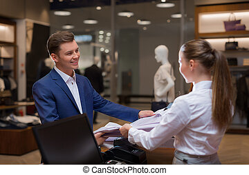 Shopaholic - Young man at a counter in store