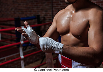 Body parts - Young man in boxing ring