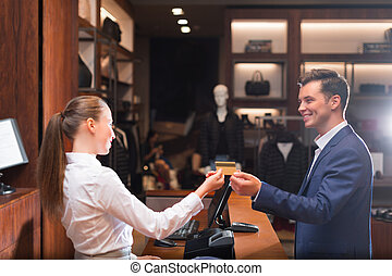 Finance - Smiling man with seller in store