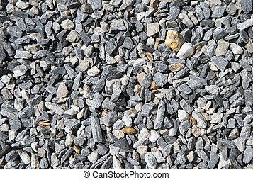Grey stony background - Closeup view of many small grey...