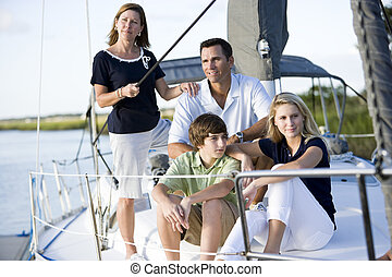 Family with teenagers relaxing together on boat - Family...
