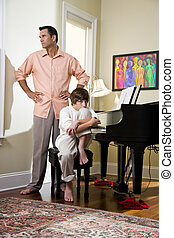 Father and teenage son at home upset