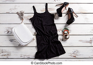 Short dress and black shoes. Glamour outfit on shop...