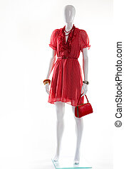 Red v-neck dress on mannequin. Female mannequin in red...